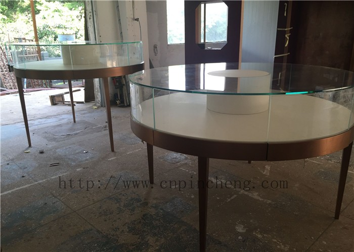 glass showcase with white glossy painting for jewelry store interior design idea