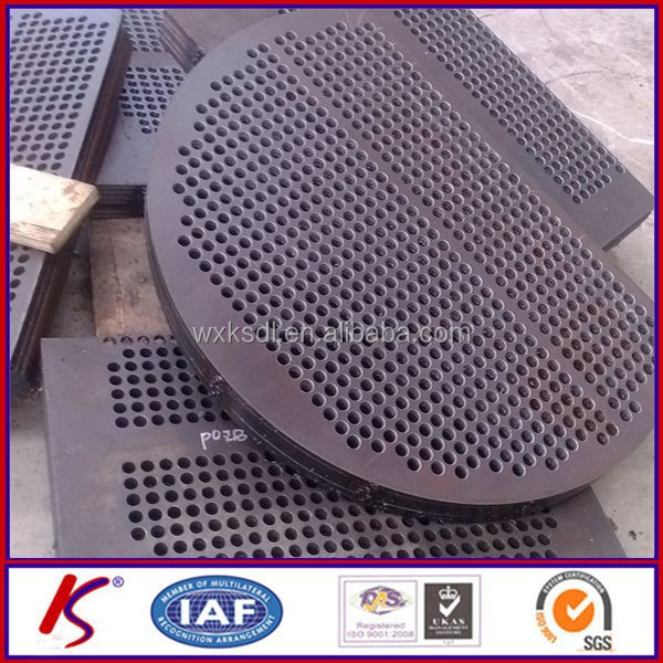 Carbon steel baffle plate for heat exchangers