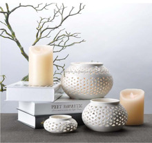 Wholesales white hollow-out flat type glazed ceramic candle holder for home decoration