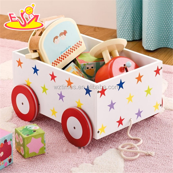 wholesale top quality MDF pull and push kids wooden toy box hot sale Wooden Storage Box with 4 Wheels W08C128
