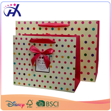 Fancy paper gift bags in colorful round dots with pasted ribbon bow tie best selling