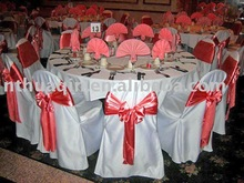 white banquet chair cover with red satin sash