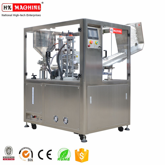 Plastic tube filling and sealing machine for creams with automatic loading tube