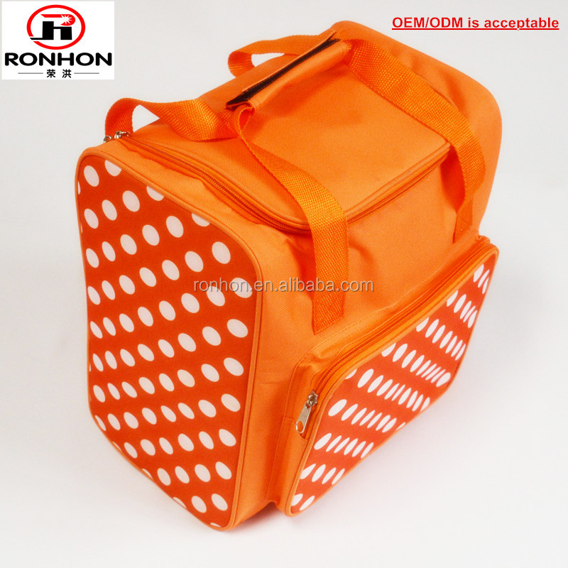 Orange rolka dot print canvas cooler tote lunch bag with front pocket