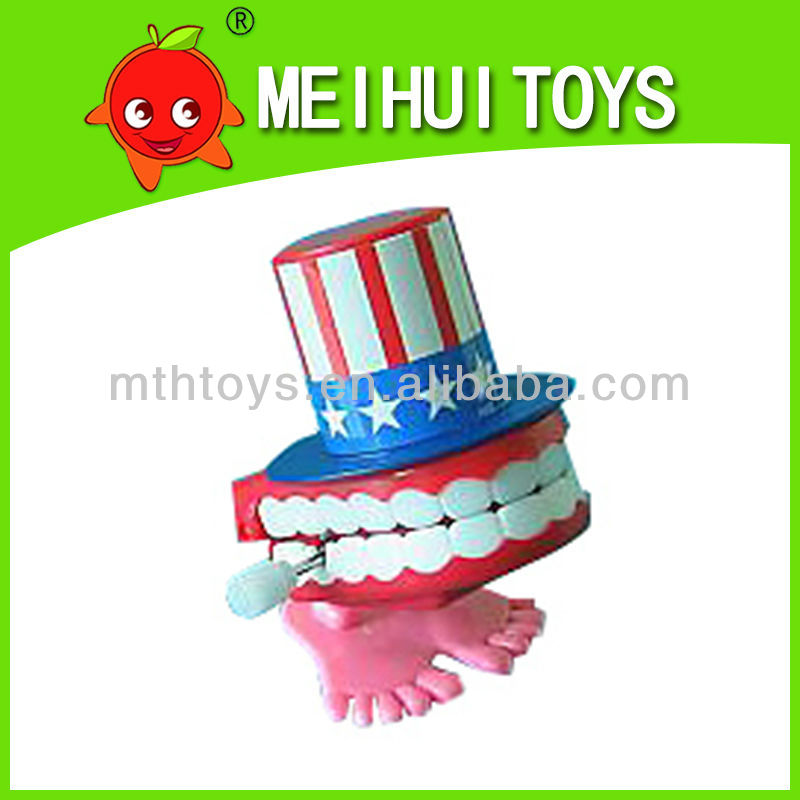 plastic jumping teeth with top hat wind up toys