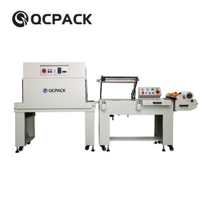 Manual wrapping machine with shrink tunnel