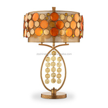 holiday hotel style gold metal table lamp with flowery sea shell decorative and cylinder shade hot sell in Bali