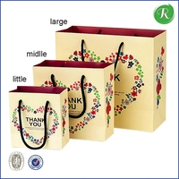 Qingdao factory sale custom printed gift paper bag/different size beautiful paper shopping bag