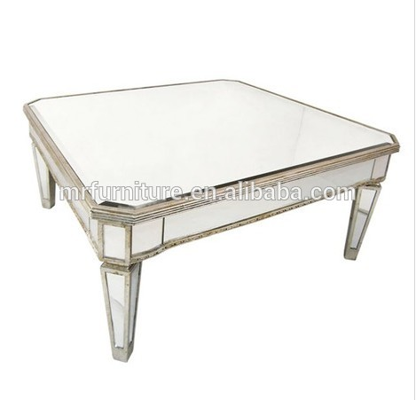 silver and gold rimming large mirrored bedside table for