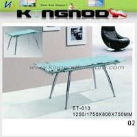 extention glass dining table with chromed tube frame