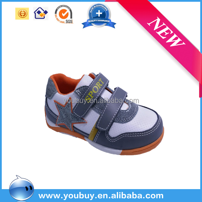 Hot selling children flat sport running shoes boy soccer shoes