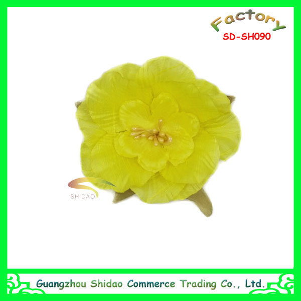 Yellow plastics flower applique hat and artificial flower corsage