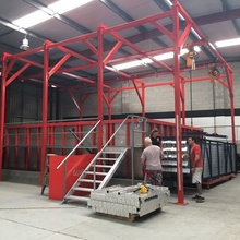 Powder coating line with pre-treatment system