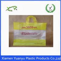 China manufacturer yellow printed shopping soft loop handle plastic bag
