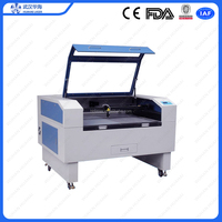 New year promotion price cnc laser cutting engraving machine for acrylic wood leather fabric MDF cnc co2 laser cutter engaver