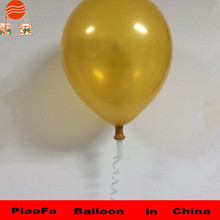 Yellow round latex balloon with ribbon for wedding party hard plastic balloon