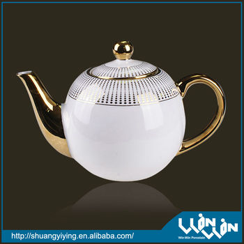 elegant porcelain tea pot in golden design