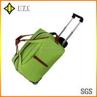 bright green waterproof wheeled canvas trolley travel bag luggage case
