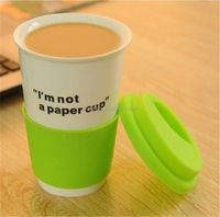 hot selling porcelain double wall coffee mug with silicone lid and coat
