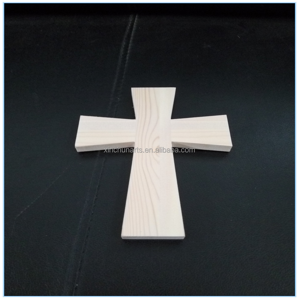 Handmade small wooden crosses for craft