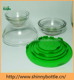 clear glass serving bowls with green lids