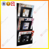 New black acrylic magazine wall holder