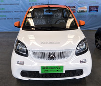 Fashionable 4 seats electric car with 5.6KW motor, good for taxi and family use