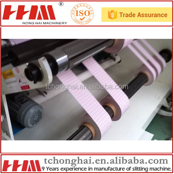 Stretch film roll slitting rewind machine