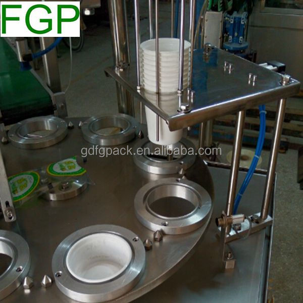 Automatic rotary yoghurt cup filling sealing packing machine with precut lid in China