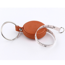 retractable leather diameter tape measure with hidden button for retract tape