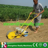 Manual hand push corn seeder/planter machine