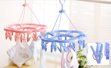 China fashion plastic clotheshorse hanging sock pegs plastic