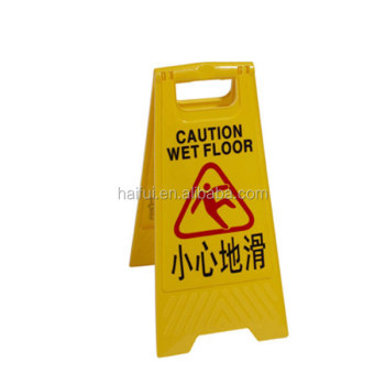 Yellow plastic folded wet floor warning sign stand