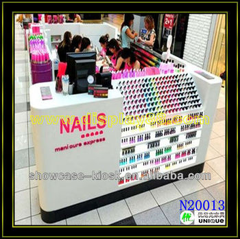 Nail kiosk with manicure and polish nail bar stand is selling here