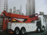 Heavy duty sinotruk howo tow truck road wrecker with 360 rotator boom
