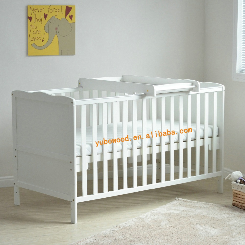 Baby cot bed with changing table