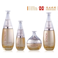Luxury packaging gold color cosmetic sets spray glass bottle with pump HY1103