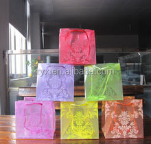 promotional cheap price christmas gift packing bag pp/pvc plastic bag with string handle