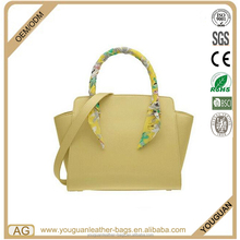 Dongguan bags manufacturer classic in style ladies trapeze bag with satin ribbon