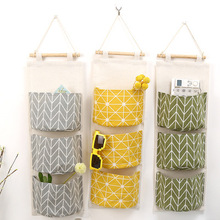 Hot selling cotton linen fabric hanging storage bag with wooden stick