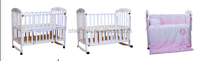 White New Zealand pine wood baby crib with storage plank