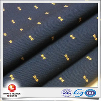 yarn dyed 100 cotton black swiss dot fabric with gold cut flower