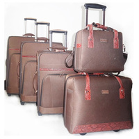 brown color fabric travel case with wheel 4 pcs travel EVA luggage bag
