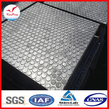 Hex shaped alumina ceramic tiles bonded to steel backing plate, coated in highly durable poly ether material