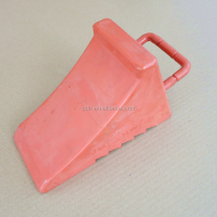 Solid rubber red wheel chock for heavy duty trucks with handle