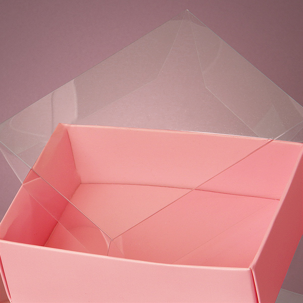 Premium paper boxes made of heavy cardstock and clear plastic covers