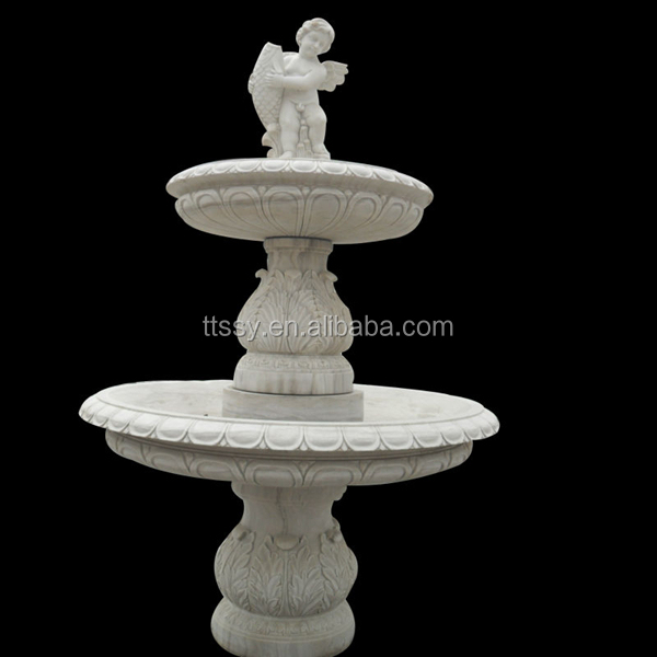 Marble fountain with angel carving