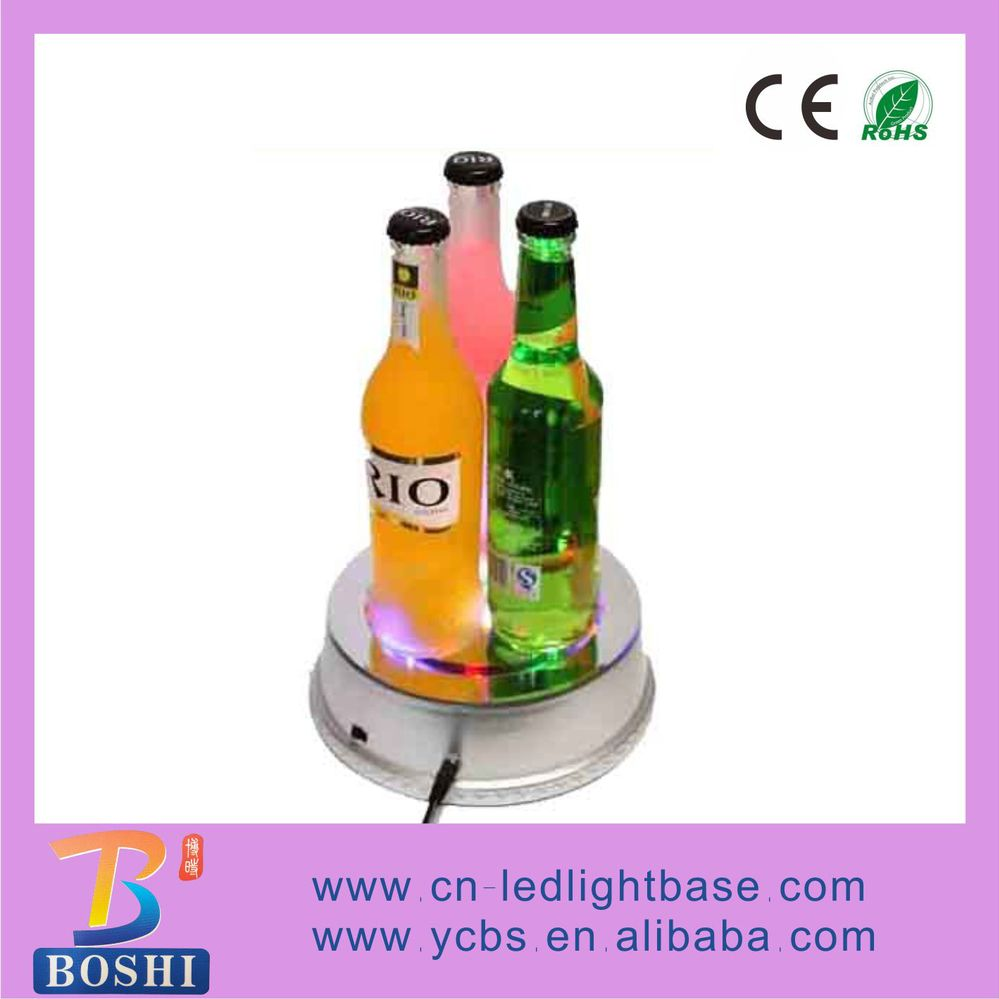 Round rotating fashion led lighted bottle bases in the bar and club