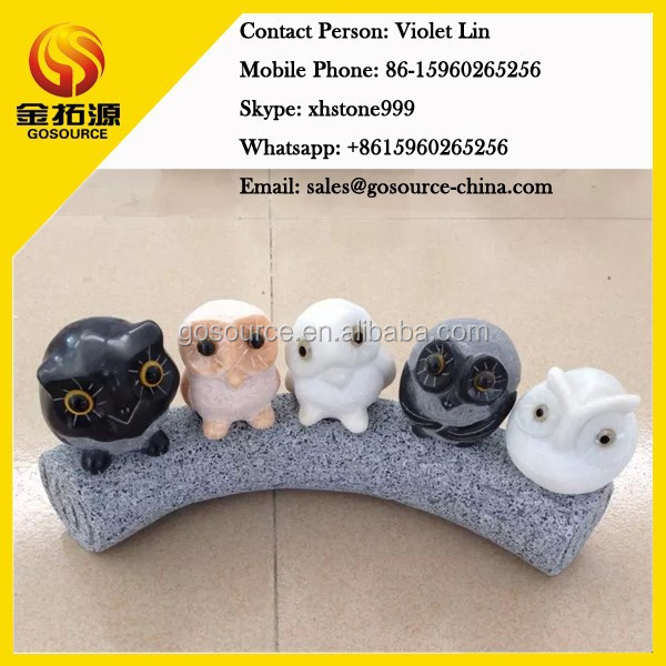marble owl statues family