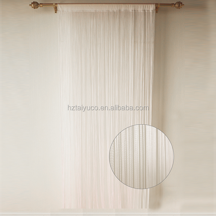 Old fashioned vintage string window curtain drapery